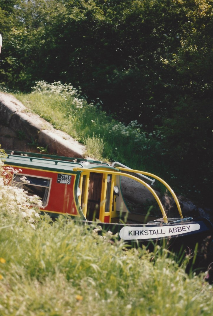 Canal boat emerging from lock